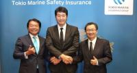 Tokio Marine Safety Insurance (Thailand) Plc executives pose together yesterday after a press conference announcing its business roadmap through the year 2022.