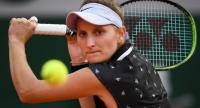 Czech Republic's Marketa Vondrousova eyes the ball as she plays a backhand return to Croatia's Petra Mart./ AFP
