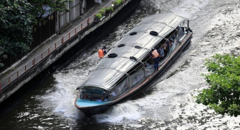Old diesel-run boats, like this one plying the Saen Saep Canal, emit black exhaust fumes, which further worsen Bangkok's air pollution.