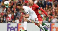 Switzerland's defender Fabian Schar (L) challenges Portugal's forward Cristiano Ronaldo during the UEFA Nations League.