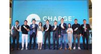 Tomson Chiu, fifth left, chief executive of ChargeSpot Thailand, at the launch of the transnational power bank sharing service in Thailand.