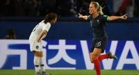 France's Amandine Henry (R) celebrates after scoring a goal during the match between France and South Korea. / AFP