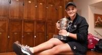 Australia's Ashleigh Barty poses with her trophy Suzanne Lenglen in the changing room.