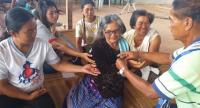 Sunee Narin, 74, participates in a blessing ceremony at home ahead of the hearing tomorrow.