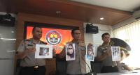 Snr. Com. Asep Adi Saputra (center), the chief spokesman of the National Police, shows pictures of suspected terrorists connected to a failed June 3 suicide attack in Kartasura, Central Java, on Monday. (JP/Delima Meylynda)