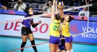 Malika Kanthong of Thailand, right,  spikes to the Brazilian players.