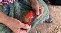 A villager shows the socalled 'healing' card she bought for Bt2,000.