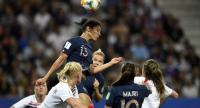 France's forward Valerie Gauvin (up) heads the ball during the France 2019 Women's World Cup Group A football match between France and Norway.