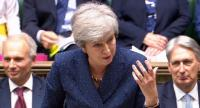 A video grab from footage broadcast by the UK Parliament's Parliamentary Recording Unit (PRU) shows Britain's PM Theresa May speaking during the weekly Prime Minister's Questions (PMQs) session in the House of Commons in London on June 12, 2019/AFP