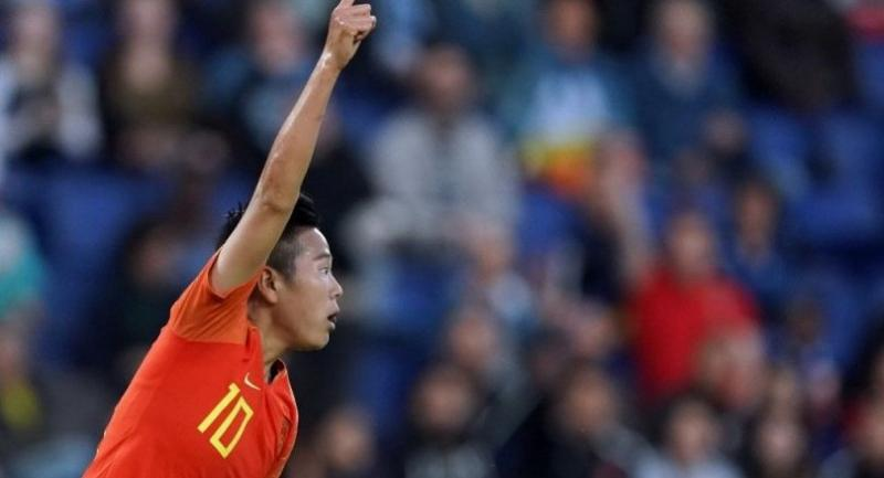 China's forward Ying Li celebrates after scoring a goal.