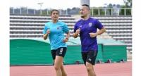 Suchawadee Nildhamrong, left, goes for a run with a member of the coaching staff during training in Nice.