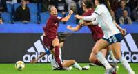 England's defender Lucy Bronze (L) vies for the ball with Argentina's midfielder Estefania Banini (2L) during the France 2019 Women's World Cup Group D football match. / AFP