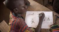 A child's drawing depicts a member of an armed group shooting a woman at the Lazare camp for internally displaced people (IDP) in Kaga Bandoro. /AFP Photo