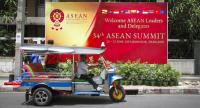 A tuk tuk drives past a large poster welcoming ASEAN leaders to the 34th ASEAN Summit in Bangkok, Thailand, 19 June 2019. // EPA-EFE PHOTO