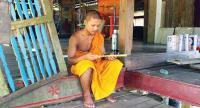 A monk studies a Buddhist manuscript |at Wat Singkhon in Myanmar's Myeik province.
