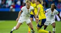 USA's Samantha Mewis (L) in action with Sweden's Nathalie Bjorn (R) during the FIFA Women's World Cup 2019 group F match between Sweden and USA in Le Havre, France.