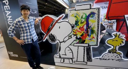 Artist Tomokazu Matsuyama with his work