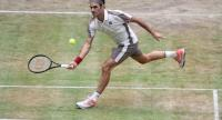 Roger Federer from Switzerland returns during his match against Roberto Bautista Agut from Spain.