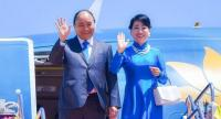 Vietnam's Prime Minister Nguyen Xuan Phuc and his wife arrive in Bangkok for the Asean Summit on Saturday.