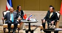 Vietnam's Prime Minister Nguyen Xuan Phuc, left, and Thai Prime Minister Prayut Chan-o-cha seen during their bilateral meeting on Saturday.