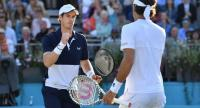 Britain's Andy Murray (L) gestures during his resumed men's quarter-final doubles match with Spain's Feliciano Lopez.