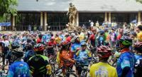 Cyclists wait to participate in a charity race at the visitor centre for the Tham Luang cave, where 12 boys from the