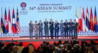 Asean leaders link hands at the opening ceremony of the summit in Bangkok.