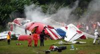 (FILES) In this file photo taken on September 17, 2007 rescue workers stand next to the wreckage of Thai budget carrier One-To-Go MD-82 plane after it crashed at Phuket airport in Phuket island. // AFP PHOTO