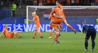 Netherlands' players celebrate at the end of the France 2019 Women's World Cup round of sixteen football match between Netherlands and Japan. / AFP
