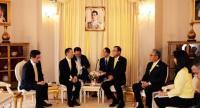 Out going JETRO President Hiroki Mitsumata, second left, introduces his successor Atsushi Taketani, left, to Prime Minister Prayut Chan-o-cha at the Government House.