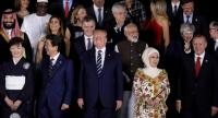 apanese Prime Minister Shinzo Abe and his wife Akie, US President Donald Trump, the Turkish President's wife Emine Erdogan and Turkish President Recep Tayyip Erdogan, pose for a group photo of heads of state and their spouses./AFP