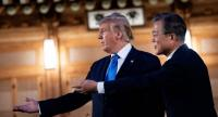US President Donald Trump and South Korea's President Moon Jae-in stand together before a working dinner at the tea house on the grounds of the presidential Blue House in Seoul on June 29, 2019./AFP