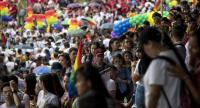 Philippine members and supporters of the LGBT community take part in a gay pride march calling for equal rights in Manila on June 29, 2019./AFP