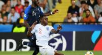England's Aaron Wan-Bissaka (R) tackles the ball under pressure from France's forward Jonathan Bamba during the Group C match of the U21 European Football Championships between England and France on June 18, 2019 at the Dino-Manuzzi stadium./AFP