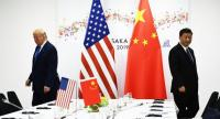 Chinese President Xi Jinping (R) and US President Donald Trump attend their bilateral meeting on the sidelines of the G20 Summit in Osaka on June 29, 2019. (Photo by Brendan Smialowski / AFP)