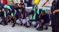 An image grab taken from a video released by Local Team on June 29, 2019, shows migrants disembarking from the Sea-Watch 3 charity ship at the Italian port of Lampedusa in the Italian port of Lampedusa, Sicily./AFP