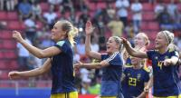 Sweden's players celebrate at the end of the France 2019 Women's World Cup quarter-final football match between Germany and Sweden. / AFP