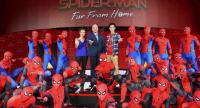 """Sony Pictures Thailand's Rachot Dhiraputra, Dujdao Promobol and actor Jirayu Tangsrisuk show off Spider-Man's signature 3-fingered web shooting gesture along with other Spidey impersonators during the gala premiere of """"Spider-Man: Far From Home."""