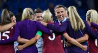 England's coach Phil Neville (C) celebrates with his players
