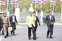 Prime Minister Prayut Chan-o-cha arrives at the Government House Tuesday.