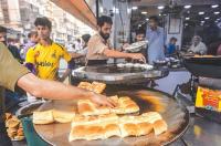 Preparing of bun kebabs ahead of the rush. - Photos by Fahim Siddiqi / White Star