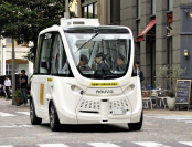A self-driving bus with no steering wheel performs a test run on a public road at Shiodome Italia-gai in Minato Ward, Tokyo.