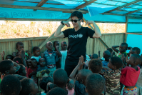 Tik Jessdaporn leads kids through a recreational activity at the Mutua shelter in Mozambique's Gondola district to help them recover from the shock of surviving a disaster.