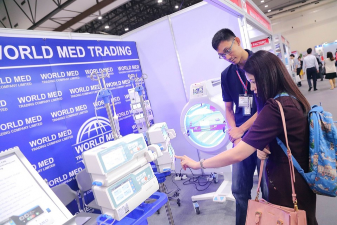 A visitor checks out one of the display booths at Medical Devices Asean in Bangkok on Wednesday.