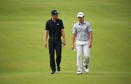 Thailand's Gunn Charoenkul playing a practice round with China's Li Haotong prior to The 148th Open