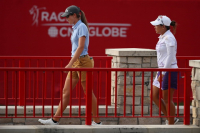 eammates Jasmine Suwannapura of Thailand (R) and Cydney Clanton of the United States walk to the 18th green. / LPGA Photo