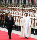 President Xi Jinping and Sheikh Mohammed bin Zayed Al Nahyan, crown prince of Abu Dhabi of the United Arab Emirates, inspect an honor guard in Beijing on Monday. [Photo by Feng Yongbin / China Daily]