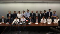 Pro-establishment lawmakers hold a joint press briefing condemning the attack on the liaison office and the beating up of suspected protesters in Yuen Long. (CALVIN NG / CHINA DAILY)
