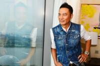 Simon Yam, 64, hopes that help can be extended to the man who surprised him on stage at a promotional event in Zhongshan in Guangdong province./photo by Lianhe Zaobao