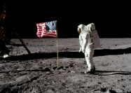 Astronaut Buzz Aldrin, lunar module pilot for Apollo 11, poses for a photograph besides the United States flag during an extravehicular activity on the moon, July 20, 1969 (Agencies photo)